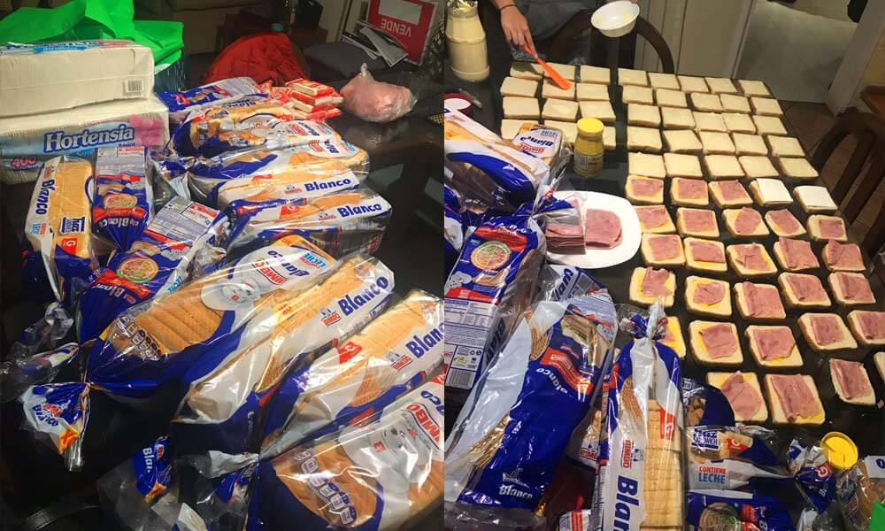 Voluntarios preparando comida para repartir entre rescatistas y daminificados